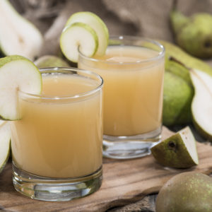 Fresh homemade Pear Juice with some fresh fruits